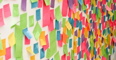 Colourful post-it notes on a wall