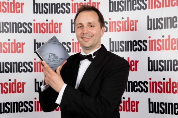 Neil Norman, Entrepreneurial Tax Partner, with award