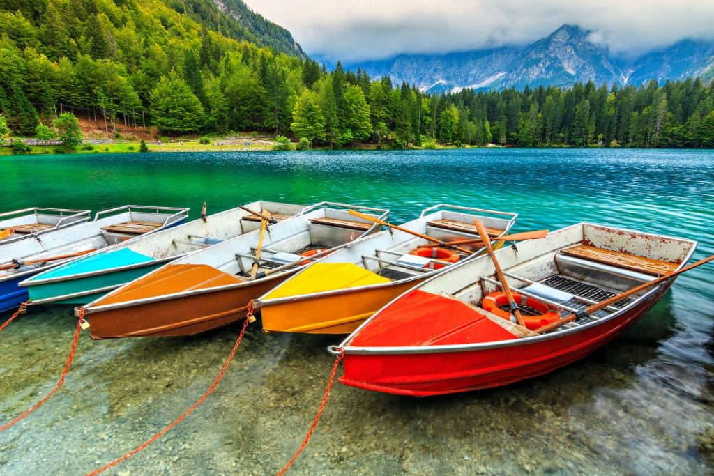 Coloured boats resting on the lake shore