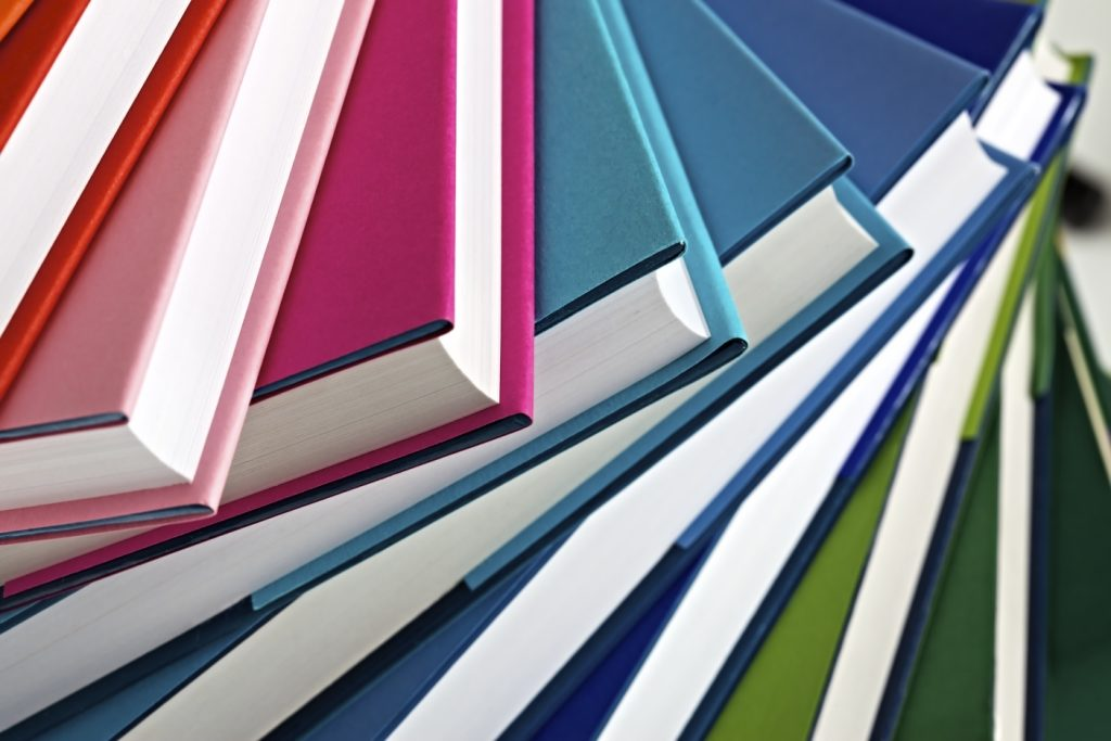A spread of books of different colours
