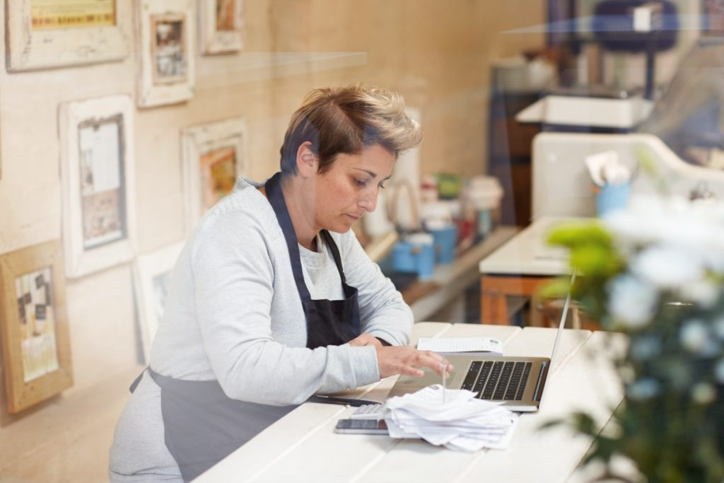 A cafe owner works on her financial records