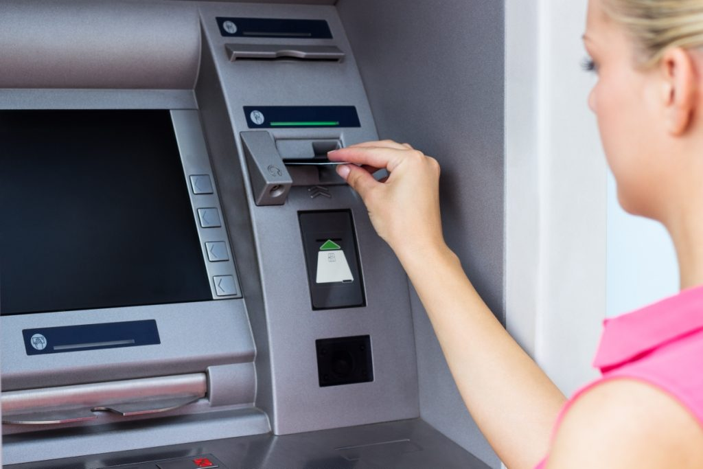 A woman using a cash machine