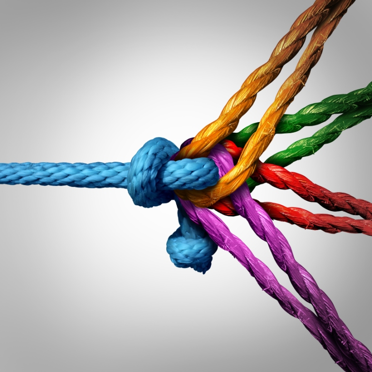 Five ropes of different colours knotted together