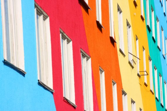 Differently-coloured houses in a block