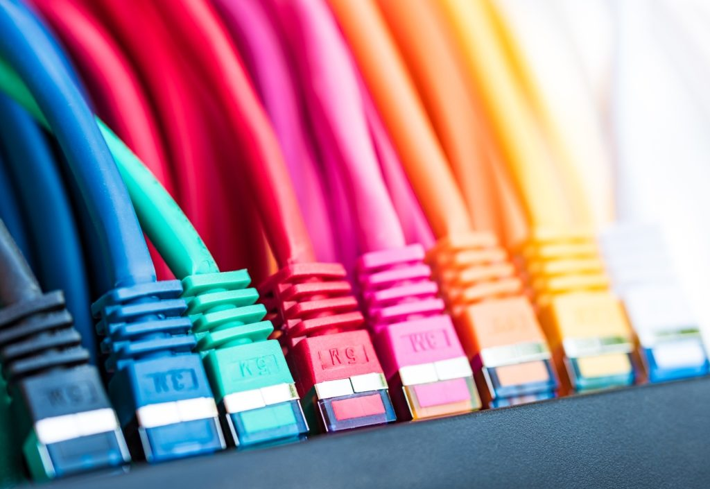 A row of differently-coloured ethernet cables