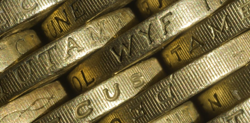 Pound coins stacked together