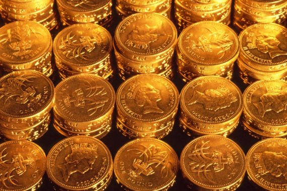 Glowing pound coins stacked in piles