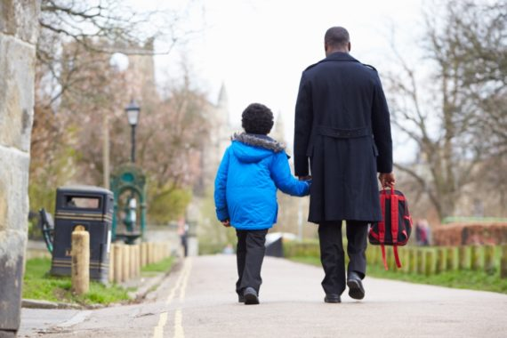 A man walking his son to school