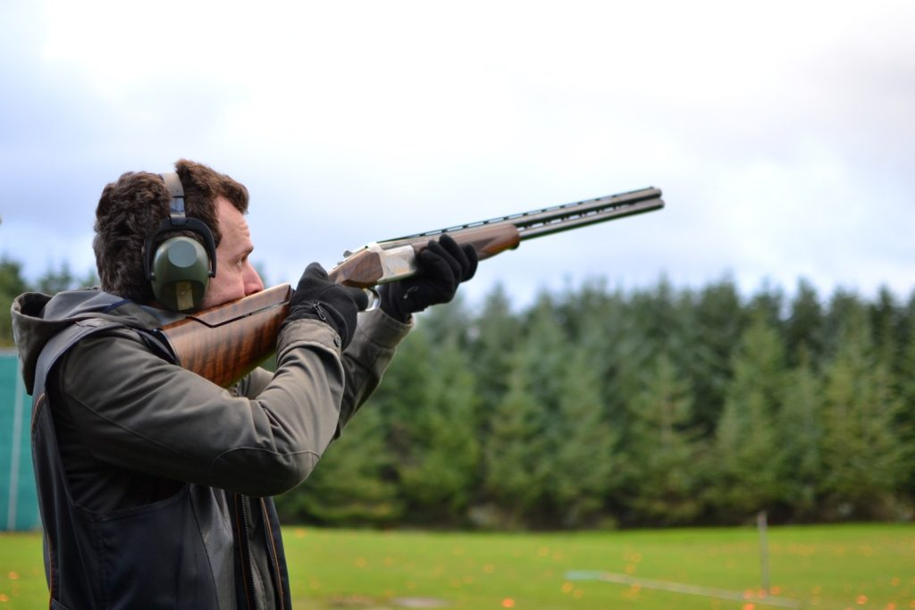 A man shooting clay pigeons