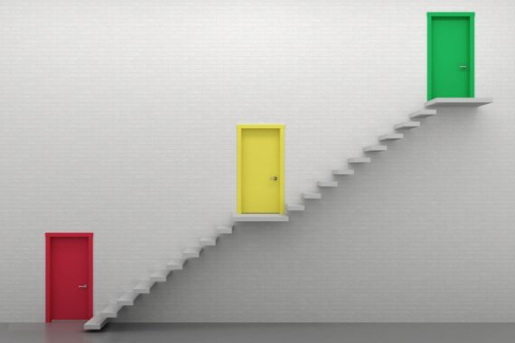 Steps leading upwards from a red door to a yellow door to a green door