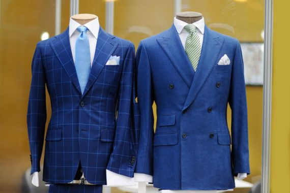 Two suits displayed on mannequins